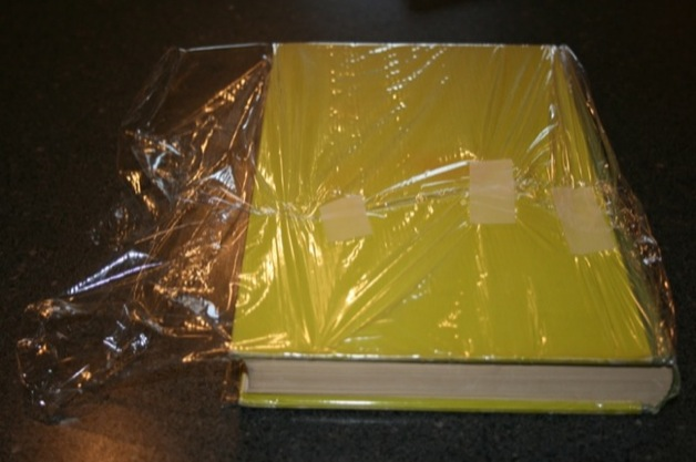 Wrap the plastic around the cover and tape it in place because you're a cautious person.